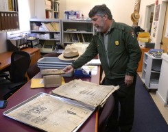 Park spokesman John Dell'Osso shows newspapers from 1929 at the Point Reyes National Seashore headquarters in Point Reyes Station, Calif. on Monday, Oct. 29, 2018. The newspapers, including issues of the San Francisco Examiner and The Defender, a paper based in Bodega, were discovered during renovation work of the Point Reyes Lighthouse. (Alan Dep/Marin Independent Journal)